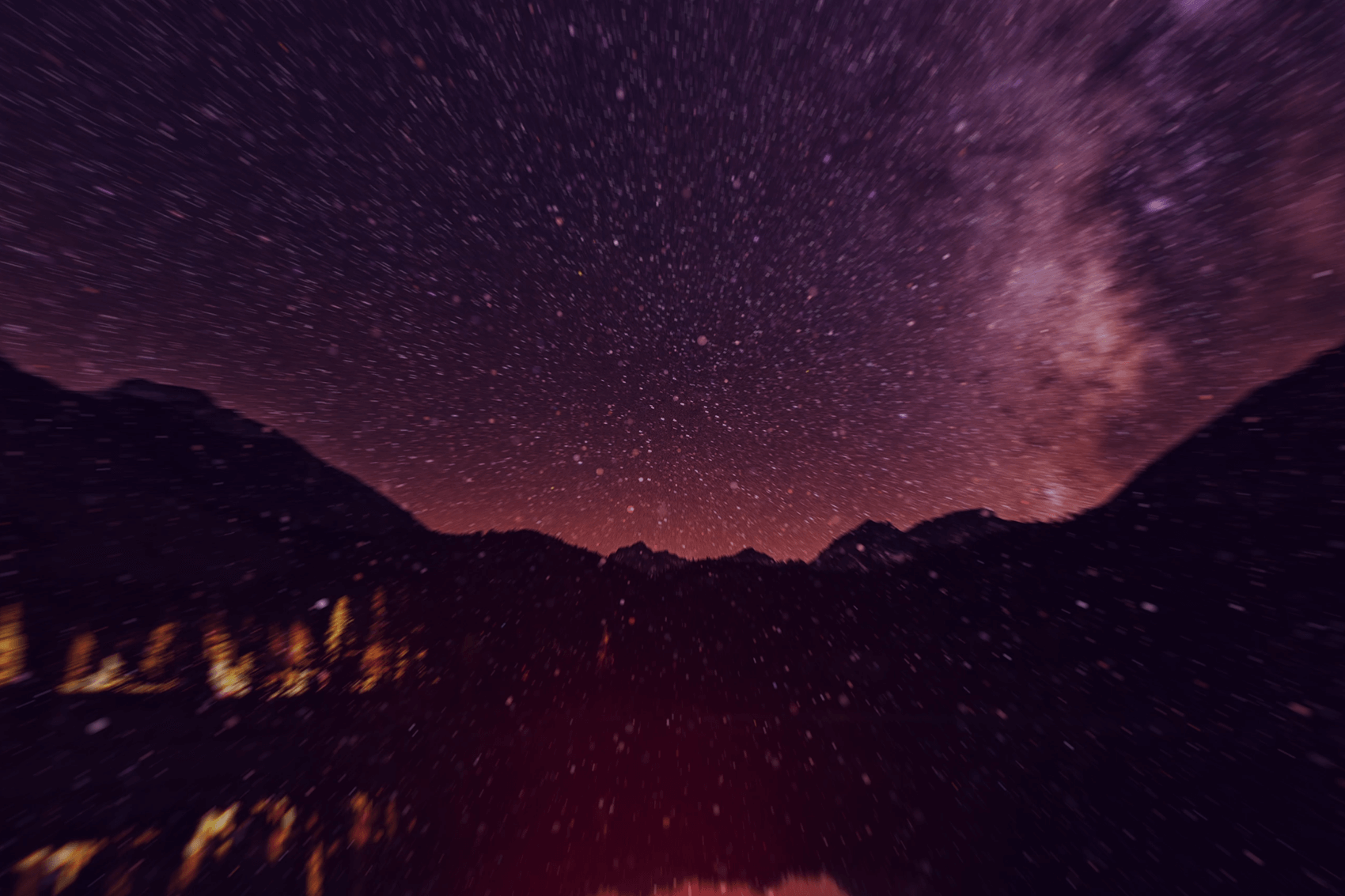 Stars particles over mountains and fire sound